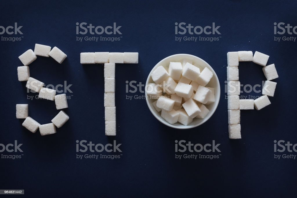 Sugar STOP sign on dark blue background royalty-free stock photo