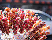 Sugar-coated haw:Chinese northern Traditional  snacks, usually sold in the winter. Hawthorn wrapped in syrup wrapped in string, sweet and sour. Modern evolved out of the use of other fruits, such as oranges, strawberries, dates, mud peach, yam and so on.