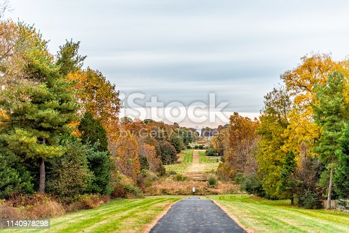istock Sugarland Run Stream Valley Trail hike in Herndon, Northern Virginia Fairfax county residential neighborhood in autumn with foliage paved path road and nobody 1140978298