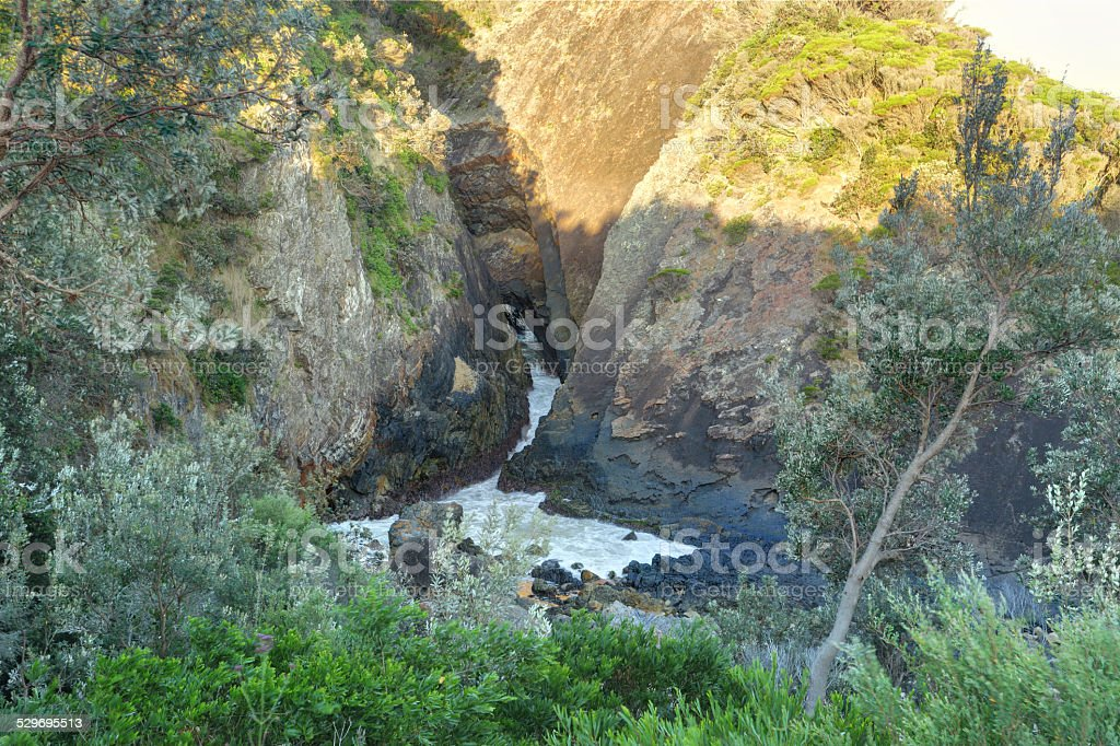 Sugarloaf Point sea chasm cave stock photo