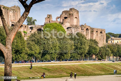 Rome, Italy, April 14 -- A suggestive cityscape on the Palatine Hill and the Circus Maximus public park. The Palatine Hill was a sacred place for the Romans where, according to tradition, the city was founded. The Roman emperors Augustus, Tiberius and Domitian built their immense imperial palaces on this hill, the remains of which are visited by millions of tourists every year as a part of the Roman Forum. Image in High Definition format.