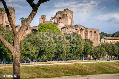 A suggestive cityscape on the Palatine Hill and the Circus Maximus public park. The Palatine Hill was a sacred place for the Romans where, according to tradition, the city was founded. The Roman emperors Augustus, Tiberius and Domitian built their immense imperial palaces on this hill. Visited every year by thousands of tourists, the Palatine Hill is part of the Archaeological Park of the Roman Imperial Forum. The Circus Maximus was the largest oval circus in the ancient world, where thousands of Romans watched epic horse and chariot races. Image in High Definition format.
