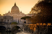 The Vatican city, the Saint Peter Cathedral in Rome city center with the Ponte Umberto I and the castle of Sant'Angelo at sunset
