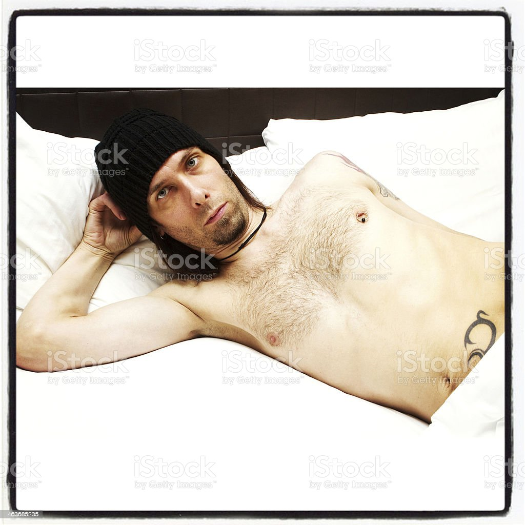 Suggestive Under The Sheets stock photo