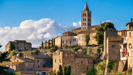 Viterbo, Lazio, Italy, February 11 -- A suggestive panoramic view of the cliff of the Cathedral of Saint Lawrence (Cattedrale di San Lorenzo) with the medieval district of San Pellegrino, in the historic heart of Viterbo. Capital of the ancient Etruscan region of Tuscia, the city of Viterbo was built on a tufaceous rock along the ancient Via Francigena, a pilgrimage route that in the Middle Ages connected southern England, France, Rome and the ports of Puglia in southern Italy, to reach the Holy Land by sailing across the Mediterranean. Image in high definition format.