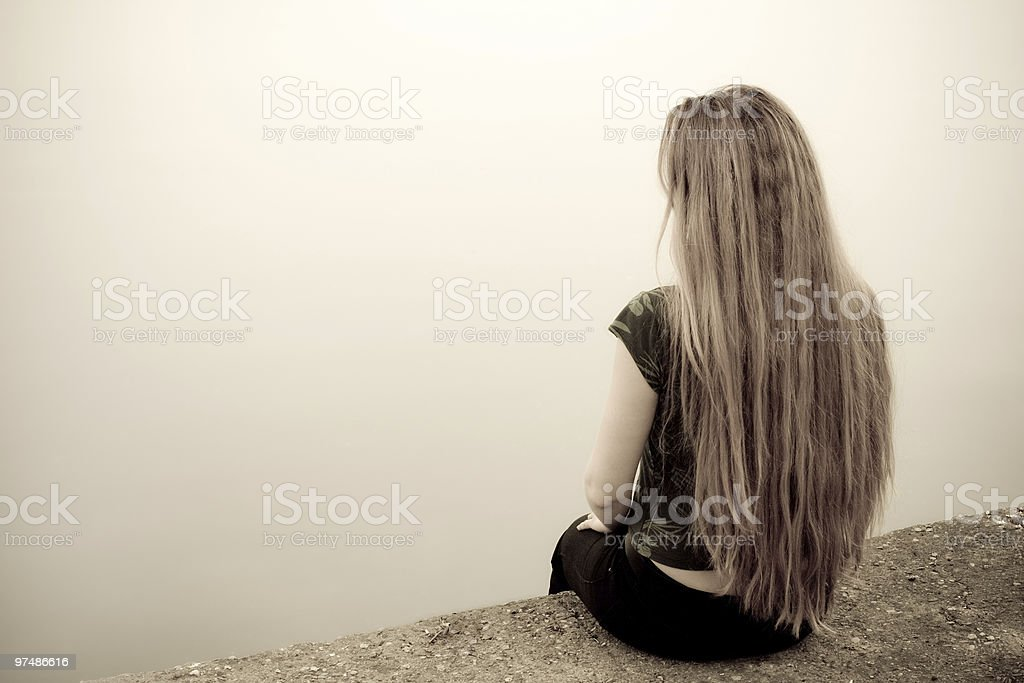 Suicidal woman threatening her own life stock photo
