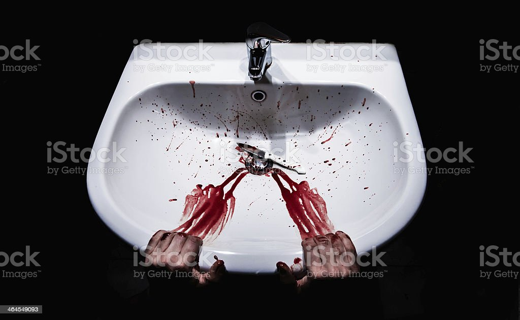 suicide concept. bleeding hands and knife in a sink stock photo