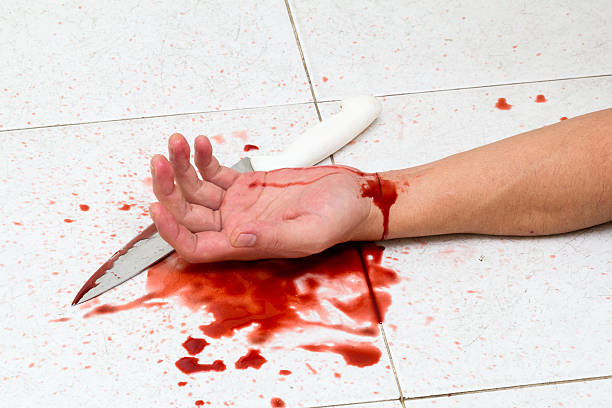 suicide - knife wound stock photos and pictures
