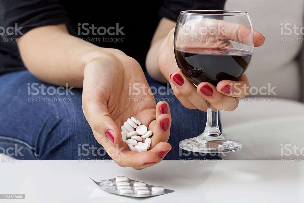 Suicide with pills and alcohol stock photo