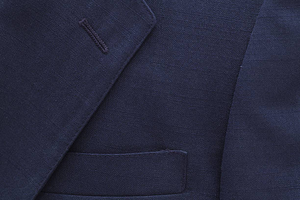 Suit Coat Background Close up view of blue suit coat... blazer jacket stock pictures, royalty-free photos & images