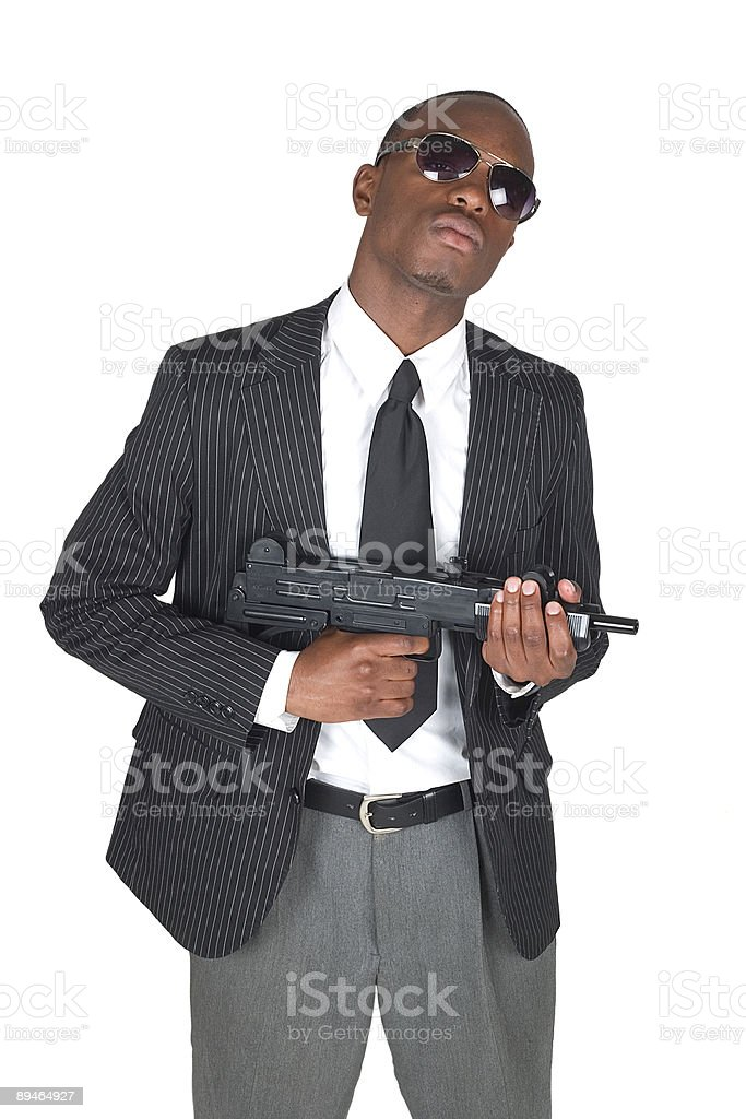 Suit, Gun, Sunglasses royalty-free stock photo