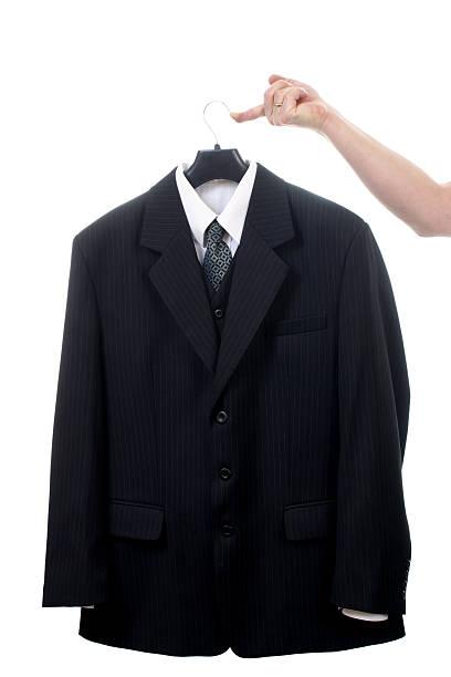 Suit on hanger stock photo
