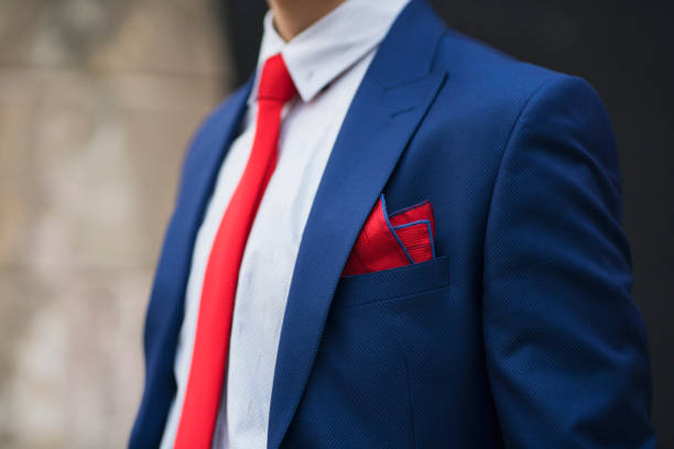 Suit Style Close-up of an unrecognizable man in an elegant suit. blazer jacket stock pictures, royalty-free photos & images