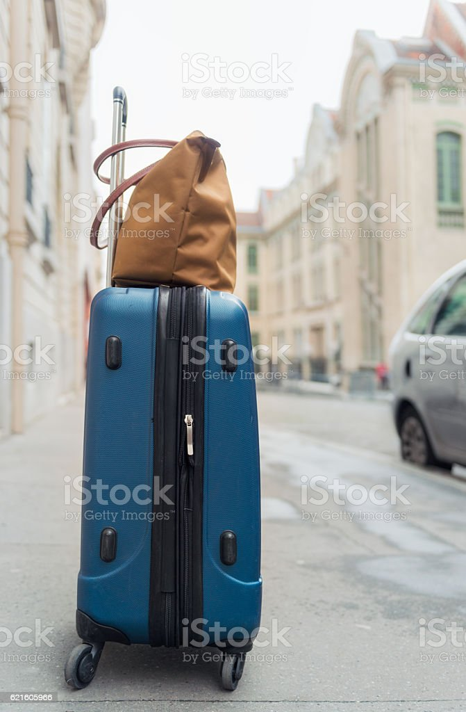 Suitcase and handbag ready for travel stock photo