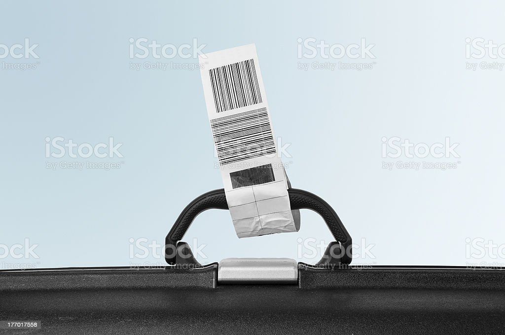 Suitcase attached with airline label stock photo
