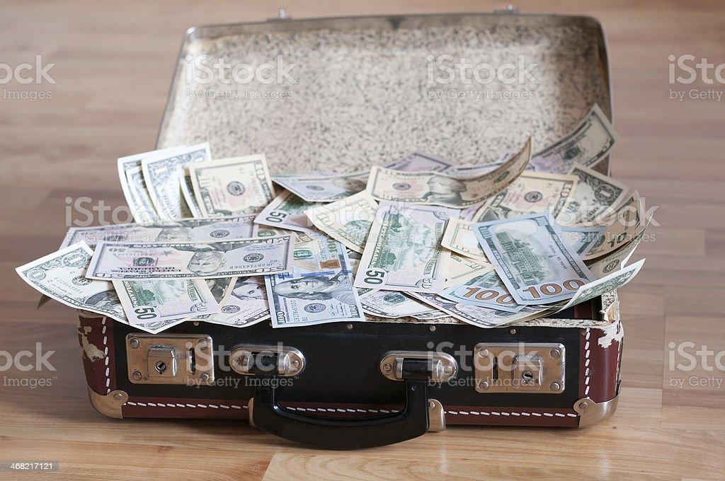 Suitcase full of money stock photo