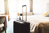 Vacation starts now. Beautiful young woman and her boyfriend arrived at the resort. They brought a big suitcase. Bright and spacious hotel room is perfect for them.