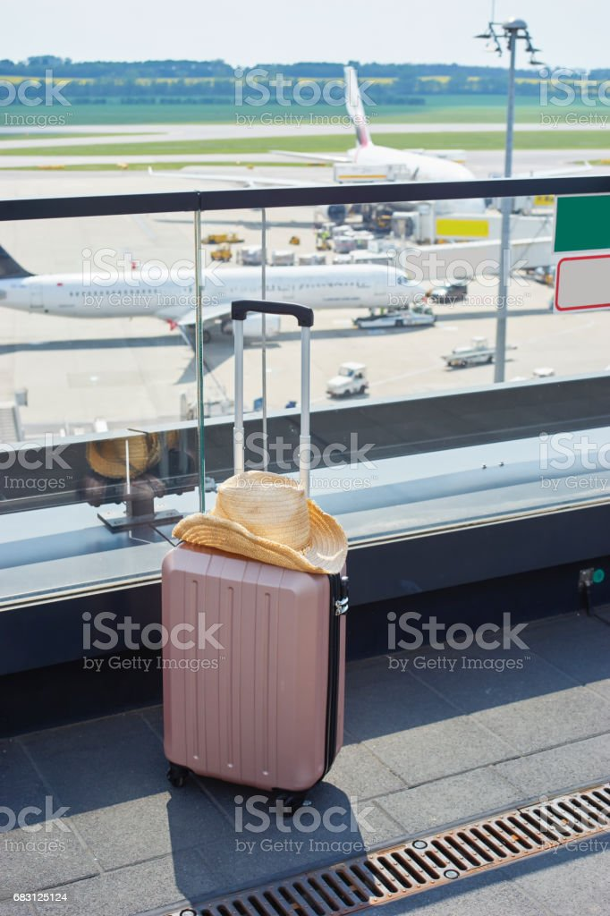 Suitcase in airport stock photo