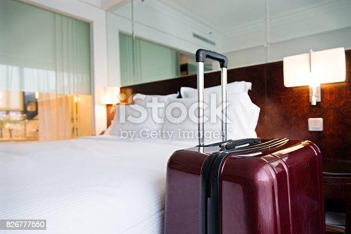 istock Suitcase in hotel room 826777550