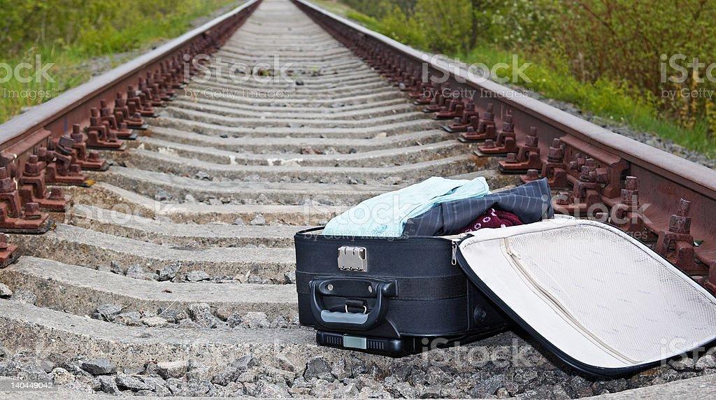 suitcase lying on the railway royalty-free stock photo