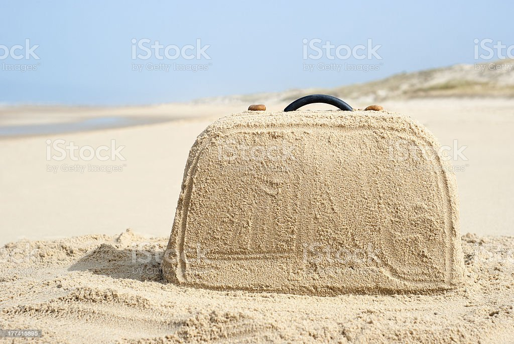 Suitcase made out of sand on beach stock photo
