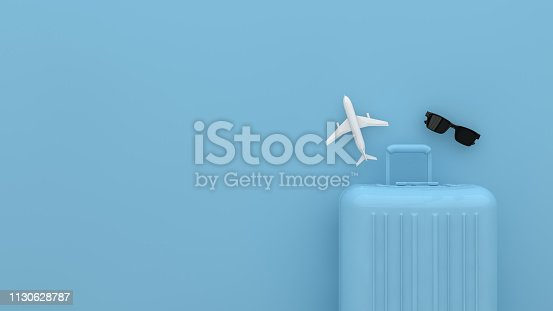 istock Suitcase, Minimal Travel Concept with blue background 1130628787