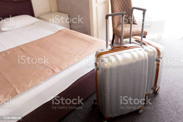 Suitcase or luggage bag in a modern hotel room picture id1026488048?b=1&k=6&m=1026488048&s=612x612&h=4obmtehjj6feyerogmgvxpgzrq08cuds0pwz co57q4=