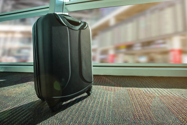 suitcase or luggage over airport background stock photo