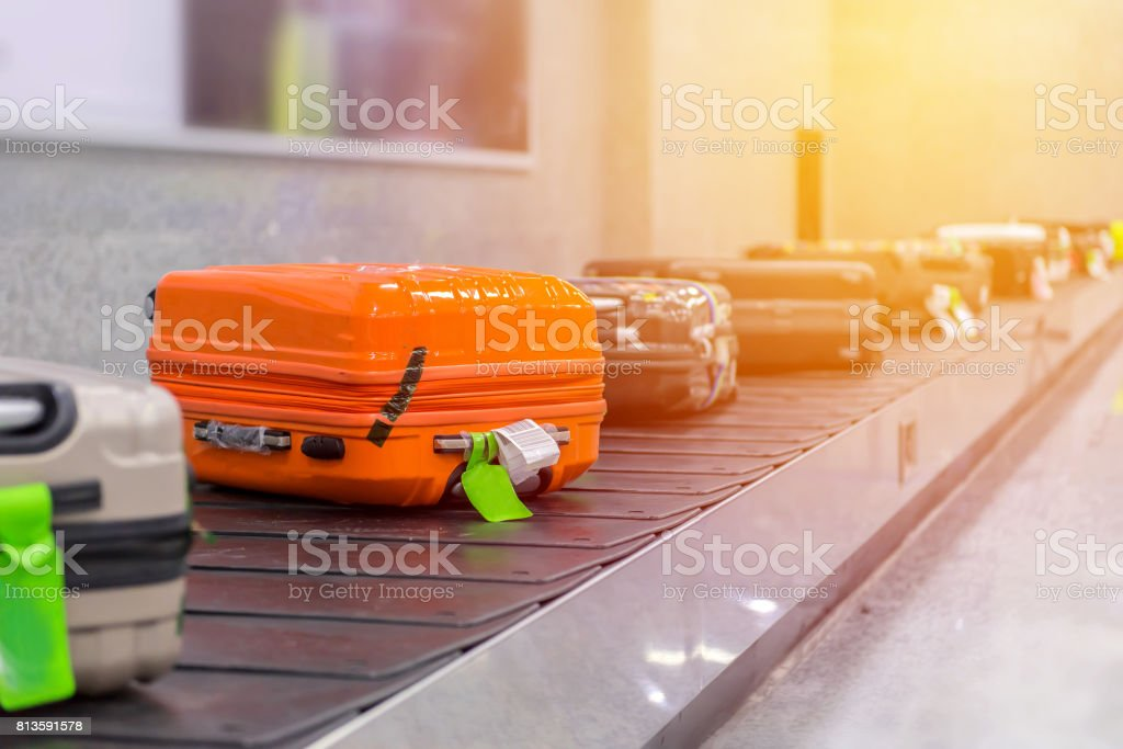 Suitcase or luggage with conveyor belt in the airport stock photo
