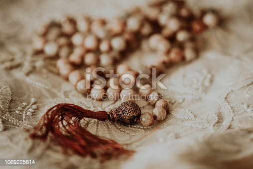 Prayer breads on top of lace. Close up