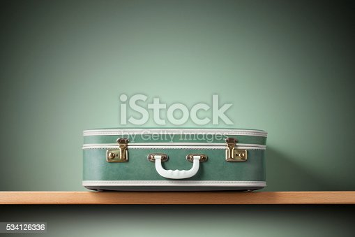 Suitcase on the shelf.