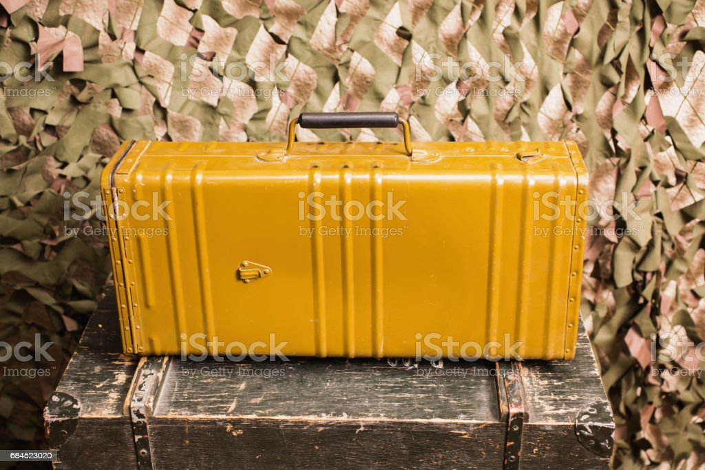 Suitcase sapper during the Second World War, against the background of a camouflage net. stock photo