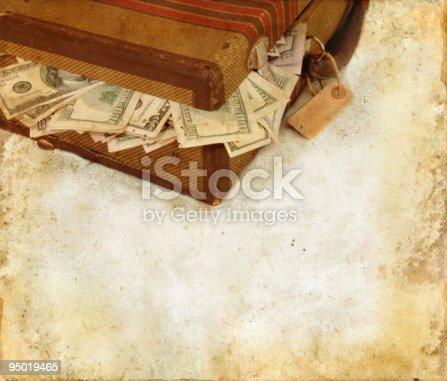 istock Suitcase Stuffed With Money Grunge Background 95019465