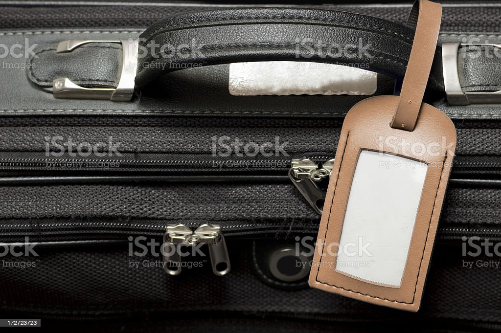 Suitcase with blank Luggage Tag stock photo