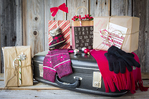 suitcase with christmas gifts ready for travel. - deko koffer stock-fotos und bilder