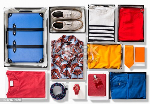 Suitcase with men's clothings isolated on white background ( with clipping path)