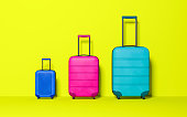 Three suitcase on pastel yellow background. Travel concept. Minimal style. Copy space. Family holiday. 3D rendering