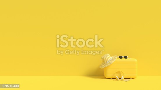 istock suitcase yellow color with sunglasses and hat on yellow background. 978749430