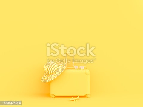 istock suitcase yellow color with sunglasses with hat and model airplane 1003904020