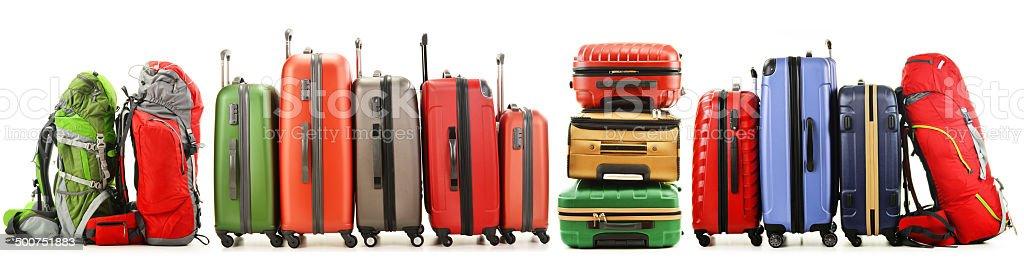 Cтоковое фото Чемоданов и рюкзаки изолированные на белом фоне