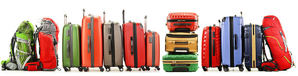 Suitcases and backpacks isolated on white background stock photo