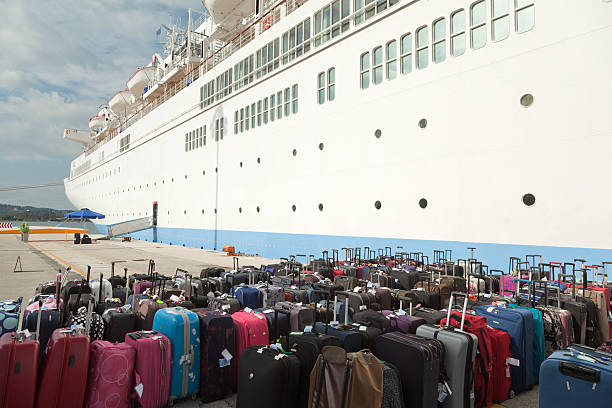 Suitcases and cruise ship at pier (XXXL) stock photo