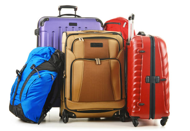 suitcases and rucksack isolated on white - luggage stock photos and pictures