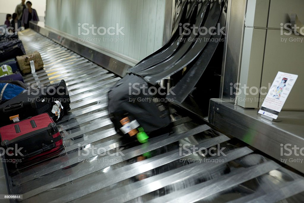 Suitcases at the airport baggage claim area royalty-free stock photo
