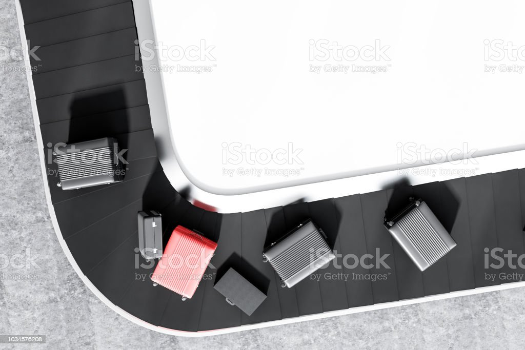 Suitcases On Airport Conveyor Belt Top View Stock Photo - Download