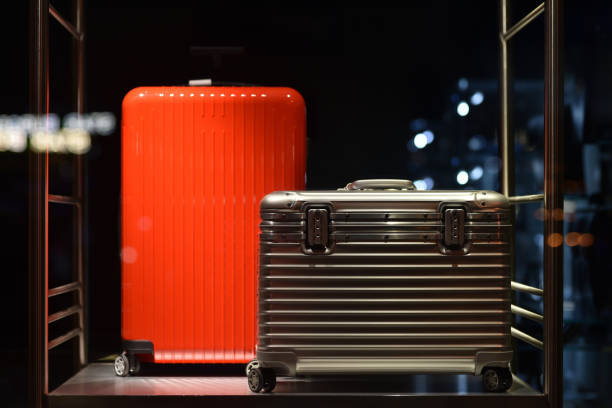 suitcases on roller wheels stock photo