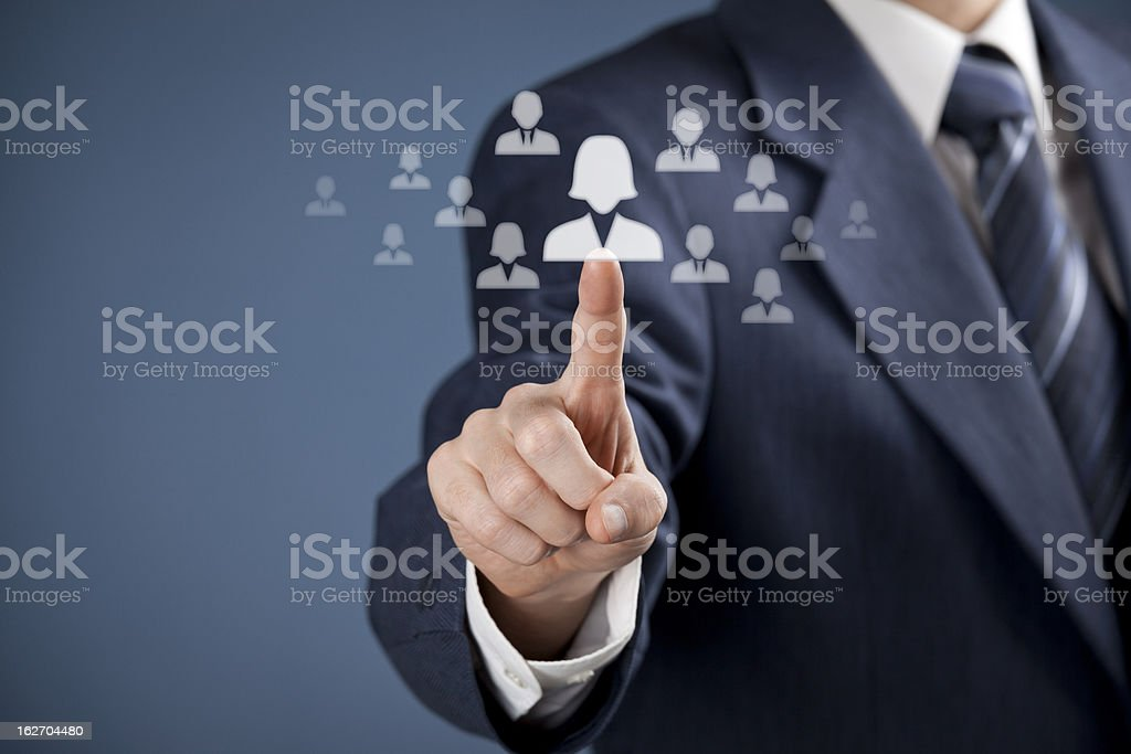 Suited man selecting a female icon from a group of genders royalty-free stock photo
