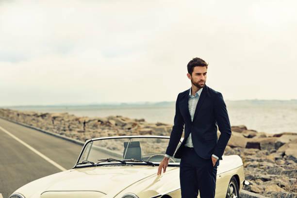 suited with vintage car - 1m coupe stock-fotos und bilder