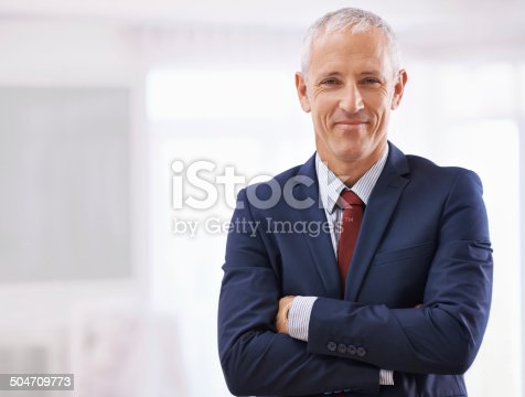 Cropped shot of a mature businessman with folded arms