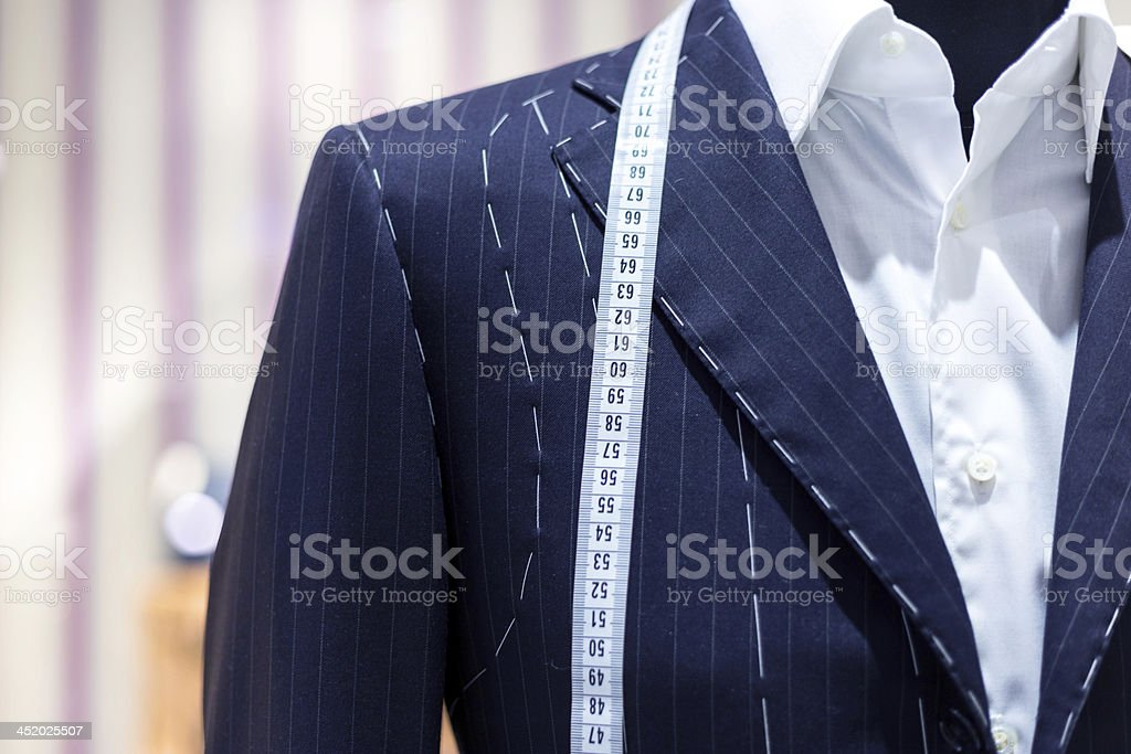 Suits on shop mannequins stock photo